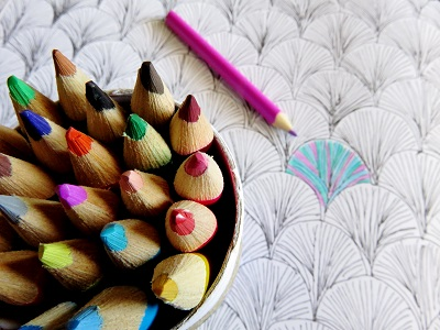 Colored pencils and adult coloring book smaller